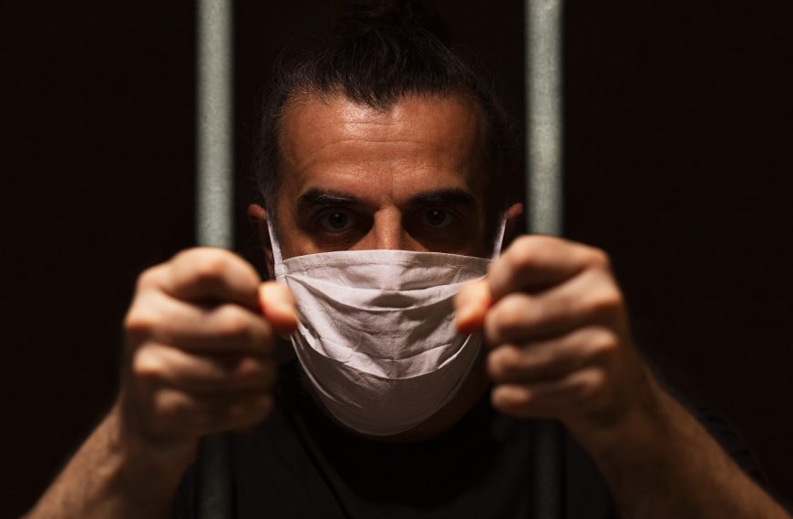 Singing, Masks, And Jail Sentences: Is This America?